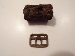 Nails and a rusted piece of iron pipe had masked this suspender clip from the 1800's despite searching the area countless times before with a number of high-end machines.